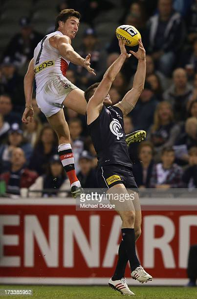 Bryce Gibbs of the Blues marks the ball in front of Lenny Hayes of the Saints during the round 16 AFL match between the Carlton Blues and the Saint...