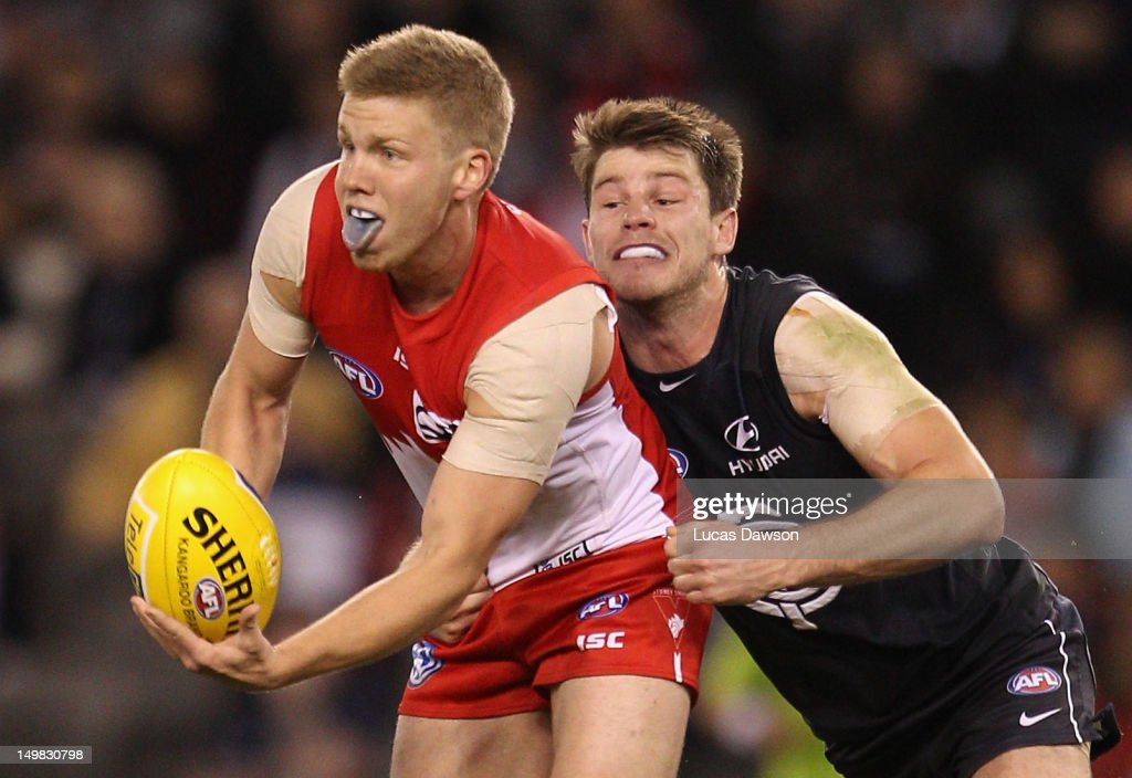 Bryce Gibbs of the Blues tackles Daniel Hannebery of Swans during the round 19 AFL match between the Carlton Blues and the Sydney Swans at Etihad Stadium on August 5, 2012 in Melbourne, Australia.