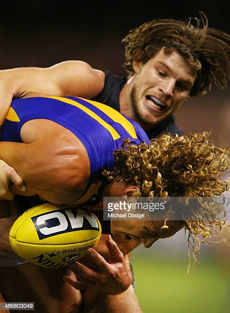Bryce Gibbs of the Blues tackles Matt Priddis of the Eagles during the round six AFL match between the Carlton Blues and the West Coast Eagles at...