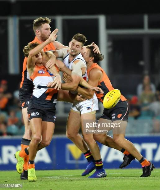 Bryce Gibbs of the Crows is surrounded by Crows players as they compete for possession during the 2019 JLT Community Series AFL match between the...
