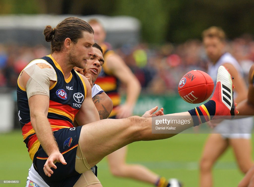 Bryce Gibbs of the Crows kicks the ball during the JLT Community Series AFL match between the Adelaide Crows and the Fremantle Dockers at Strathalbyn Oval on February 25, 2018 in Adelaide, Australia.