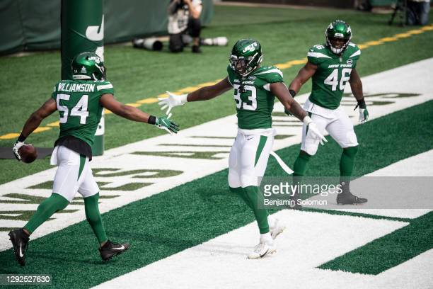 Bryce Hager and Josh Malone of the New York Jets react after scoring a touchdown during a game against the Arizona Cardinals at MetLife Stadium on...