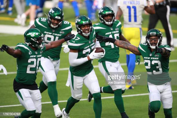 Bryce Hall of the New York Jets celebrates with teammates following an interception during the second quarter of a game against the Los Angeles Rams...