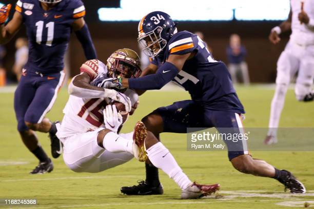 Bryce Hall of the Virginia Cavaliers breaks up a pass intended for Tamorrion Terry of the Florida State Seminoles in the first half during a game at...