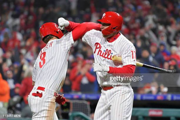 Bryce Harper and Rhys Hoskins of the Philadelphia Phillies celebrate Harpers home run in the seventh inning against the Atlanta Braves at Citizens...
