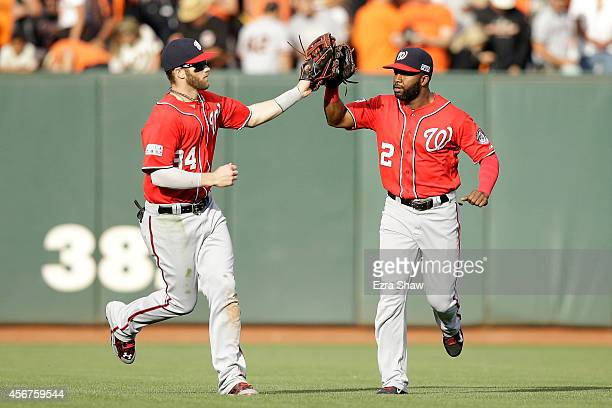 Bryce Harper celebrates with Denard Span of the Washington Nationals after their 4 to 1 win over the San Francisco Giants during Game Three of the...