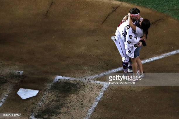 Bryce Harper celebrates with his wife Kayla Varner during the TMobile Home Run Derby at Nationals Park on July 16 2018 in Washington DC