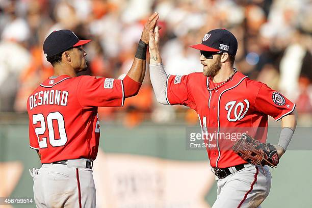 Bryce Harper celebrates with Ian Desmond of the Washington Nationals after their 4 to 1 win over the San Francisco Giants during Game Three of the...