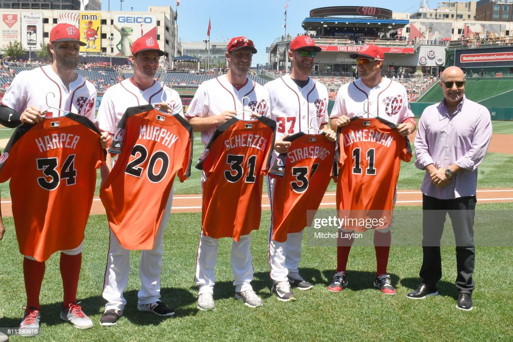 Bryce Harper #34, Daniel Murphy #20, Max Scherzer #31, Stephen Strasburg #37, Ryan Zimmerman #11 of the Washington Nationals pose with their All-Star jerseys with General Manager Mike Rizzo before a baseball game against the Atlanta Braves at Nationals Park on July 9, 2017 in Washington, DC.