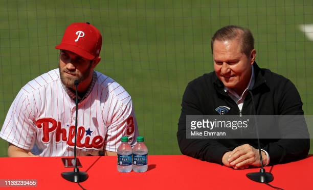 Bryce Harper is introduced to the Philadelphia Phillies with agent Scott Boras during a press conference at Spectrum Stadium on March 02, 2019 in...