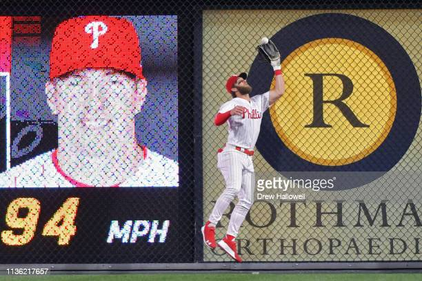 Bryce Harper of the Philadelphia Phillies catches a fly ball at the wall in the second inning against the Washington Nationals at Citizens Bank Park...
