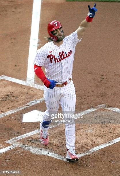 Bryce Harper of the Philadelphia Phillies celebrates after hitting a three-run home run in the first inning during a game against the Atlanta Braves...