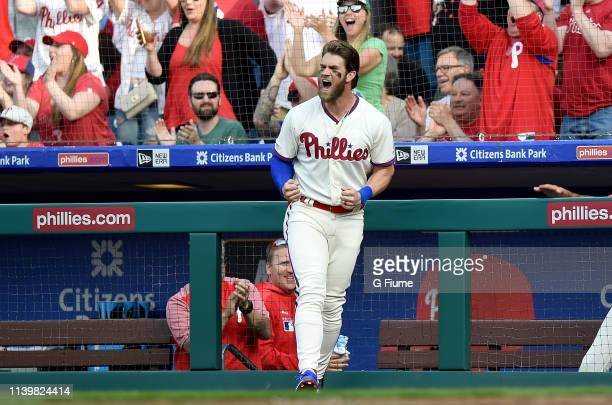 Bryce Harper of the Philadelphia Phillies celebrates after Maikel Franco hits a home run against the Atlanta Braves at Citizens Bank Park on March 30...