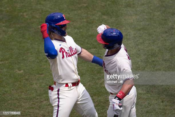 Bryce Harper of the Philadelphia Phillies celebrates with J.T. Realmuto after hitting a three run home run in the bottom of the first inning against...