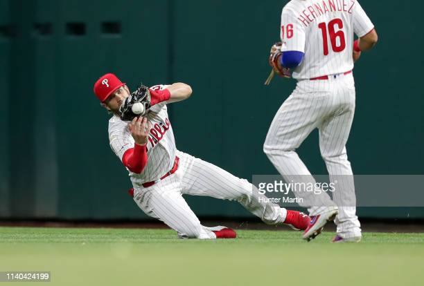 Bryce Harper of the Philadelphia Phillies commits an error attempting to catch a fly ball in the eighth inning during a game against the Detroit...