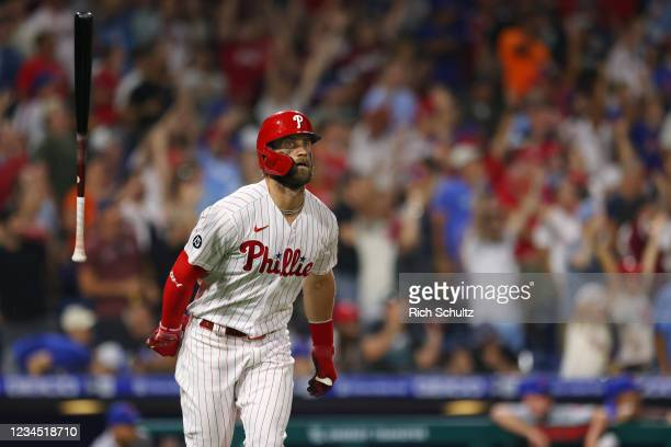Bryce Harper of the Philadelphia Phillies flips his bat after hitting a two-run home run against the New York Mets during the eighth inning of a game...