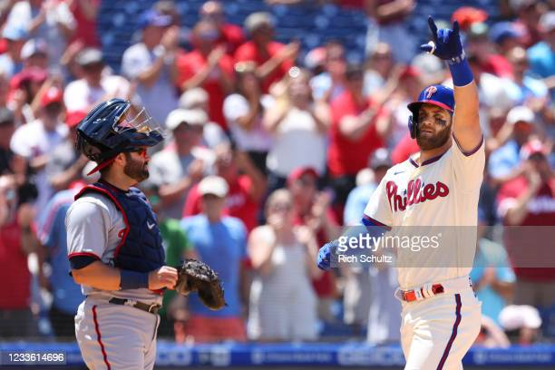 Bryce Harper of the Philadelphia Phillies gestures after he hit a home run against the Washington Nationals during the third inning of a game at...