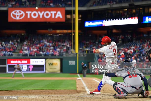 Bryce Harper of the Philadelphia Phillies hits a home run in the seventh inning against the Atlanta Braves at Citizens Bank Park on March 31 2019 in...