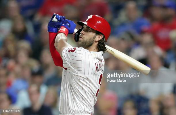 Bryce Harper of the Philadelphia Phillies hits a three-run home run in the sixth inning during a game against the San Diego Padres at Citizens Bank...