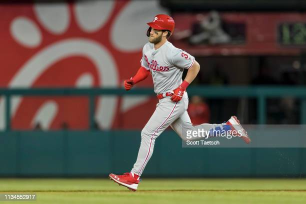 Bryce Harper of the Philadelphia Phillies hits a tworun home run against the Washington Nationals during the eighth inning at Nationals Park on April...