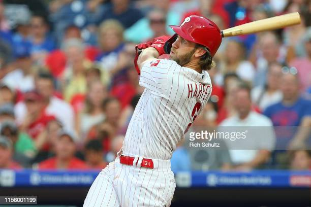 Bryce Harper of the Philadelphia Phillies hits a tworun home run against the Los Angeles Dodgers during the second inning of a baseball game at...