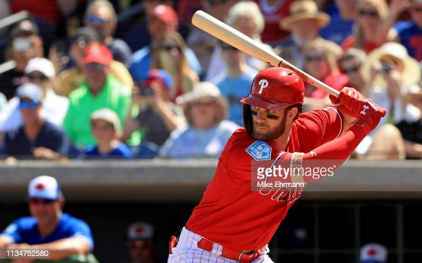 Bryce Harper of the Philadelphia Phillies hits in the first inning during a game against the Toronto Blue Jays on March 09 2019 in Clearwater Florida