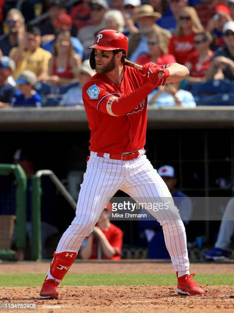 Bryce Harper of the Philadelphia Phillies hits in the third inning during a game against the Toronto Blue Jays on March 09 2019 in Clearwater Florida