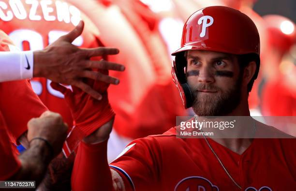 Bryce Harper of the Philadelphia Phillies is congratulated after coming out of the game in the third inning during a game against the Toronto Blue...