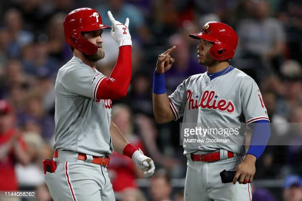 Bryce Harper of the Philadelphia Phillies is congratulated by Cesar Hernandez after hitting a 3 RBI home run in the seventh inning against the...