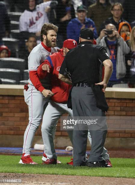 Bryce Harper of the Philadelphia Phillies is ejected by home plate umpire Mark Carlson during their game against the New York Mets at Citi Field on...
