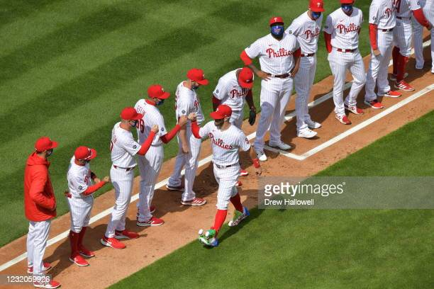 Bryce Harper of the Philadelphia Phillies is greeted by teammates before the game against the Atlanta Braves on Opening Day at Citizens Bank Park on...