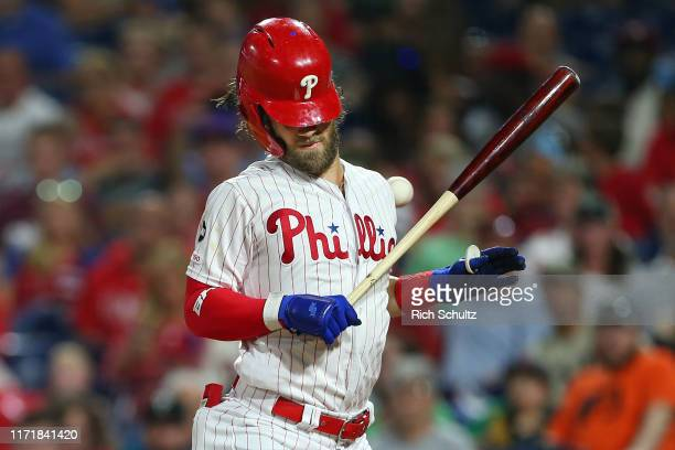 Bryce Harper of the Philadelphia Phillies is hit in the back by a pitch from Jose Quijada of the Miami Marlins during the fourth inning of a game at...