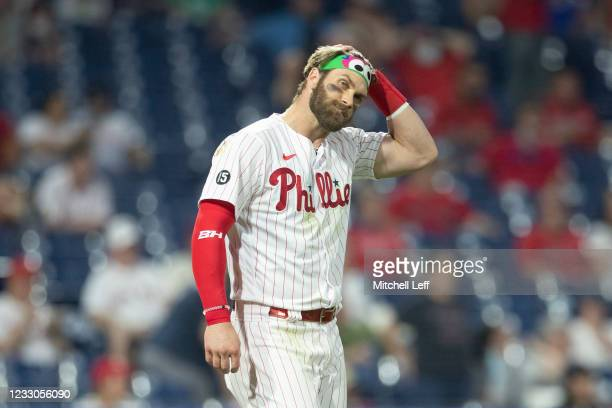 Bryce Harper of the Philadelphia Phillies looks on after striking out to end the third inning against the Boston Red Sox at Citizens Bank Park on May...