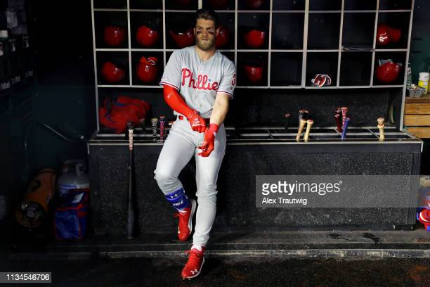 Bryce Harper of the Philadelphia Phillies looks on from the dugout prior to the game between the Philadelphia Phillies and the Washington Nationals...