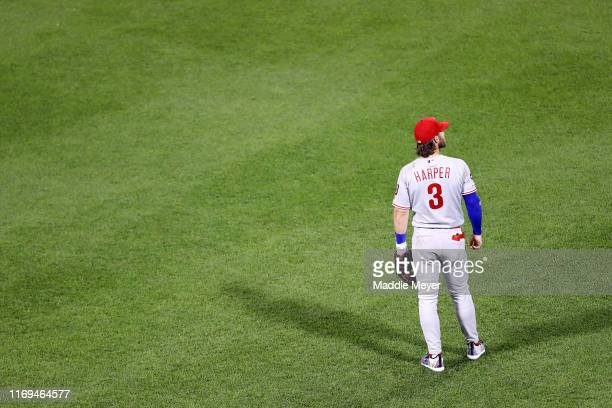 Bryce Harper of the Philadelphia Phillies looks on from the outfield during the second inning against the Boston Red Sox at Fenway Park on August 21...