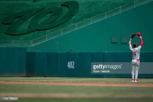 April 03: Bryce Harper of the Philadelphia Phillies makes a gesture to fans against the Washington Nationals during the first inning at Nationals...