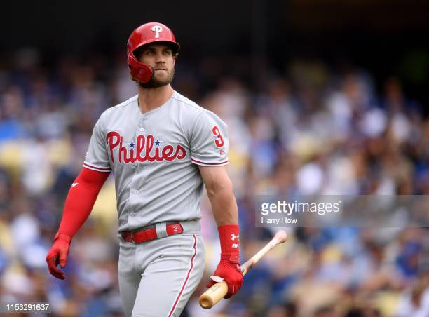 Bryce Harper of the Philadelphia Phillies reacts after his strikeout during the sixth inning against the Los Angeles Dodgers at Dodger Stadium on...