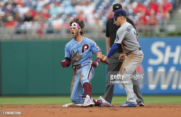 Bryce Harper of the Philadelphia Phillies reacts after hitting a single and taking second base on an error that scored a run in the seventh inning...