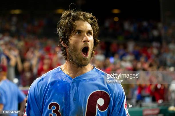 Bryce Harper of the Philadelphia Phillies reacts after hitting a walk-off grand slam against the Chicago Cubs at Citizens Bank Park on August 15,...