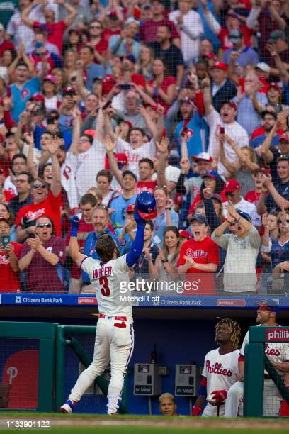 Bryce Harper of the Philadelphia Phillies reacts after hitting a solo home run in the bottom of the seventh inning against the Atlanta Braves at...