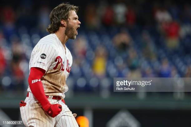 Bryce Harper of the Philadelphia Phillies reacts after hitting a walkoff two run double in the ninth inning to defeat the Los Angeles Dodgers 98 in a...