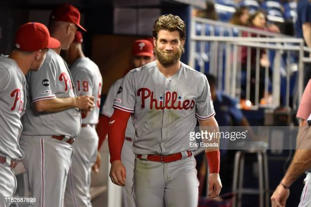 Bryce Harper of the Philadelphia Phillies reacts in the dugout after striking out in the eighth inning against the Miami Marlins at Marlins Park on...