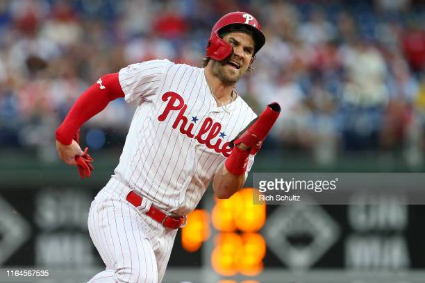 Bryce Harper of the Philadelphia Phillies rounds third base as he scores on a double by Rhys Hoskins against the Pittsburgh Pirates during the third...