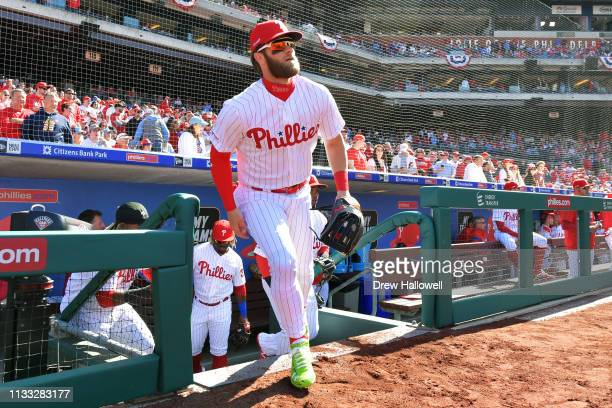 Bryce Harper of the Philadelphia Phillies runs onto the field before the game against the Atlanta Braves on Opening Day at Citizens Bank Park on...