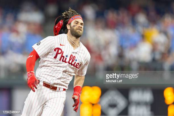 Bryce Harper of the Philadelphia Phillies runs to third base on his way to an inside the park home run in the bottom of the fifth inning against the...