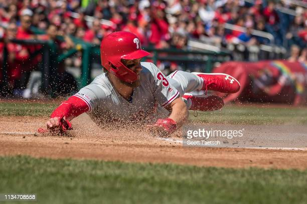 April 03: Bryce Harper of the Philadelphia Phillies scores a run against the Washington Nationals during the first inning at Nationals Park on April...
