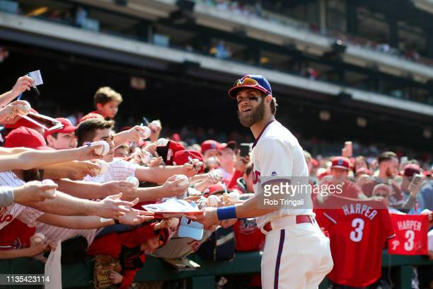 Bryce Harper of the Philadelphia Phillies signs autographs prior to the game between the Minnesota Twins and the Philadelphia Phillies at Citizens...