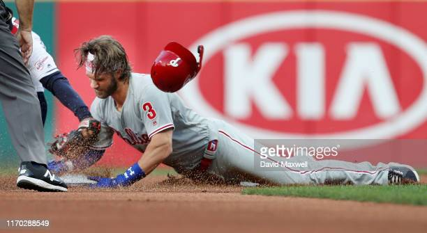 Bryce Harper of the Philadelphia Phillies slides into second base with a double against the Cleveland Indians in the first inning at Progressive...