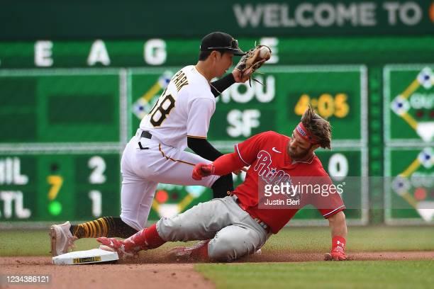 Bryce Harper of the Philadelphia Phillies slides safely into second base past Hoy Park of the Pittsburgh Pirates for a double in the seventh inning...