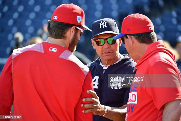 Bryce Harper of the Philadelphia Phillies speaks with Reggie Jackson of the New York Yankees before the spring training game against the New York...